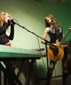 team singing music instrument