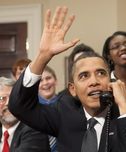 Obama waving and making call with family