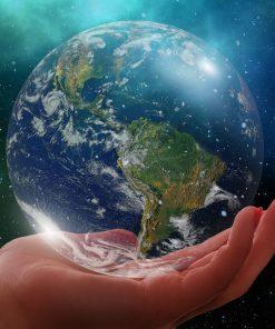 globe nature scene hands